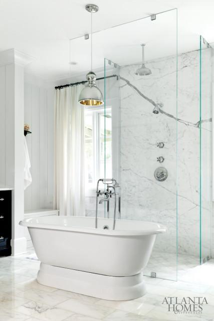 The master bath has a spa-like ambience, thanks to a soaking tub and a nearly invisible walk-in shower that's backed by a luxurious marble-lined wall.