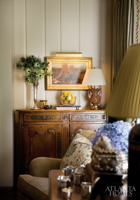 A painting by Winslow Homer hangs above a French console. The room's paint color is Benjamin Moore's Bleeker Beige.