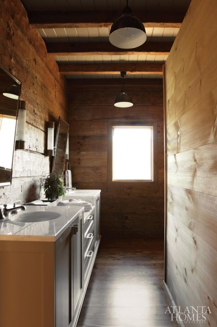 With elegant fixtures and an expansive walk-in shower, the master bath proves that 'rustic' and 'refined' aren't mutually exclusive.
