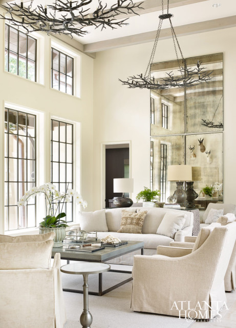 A pair of chandeliers by Darren Hardeman evoke winter branches and hang over an arrangement of