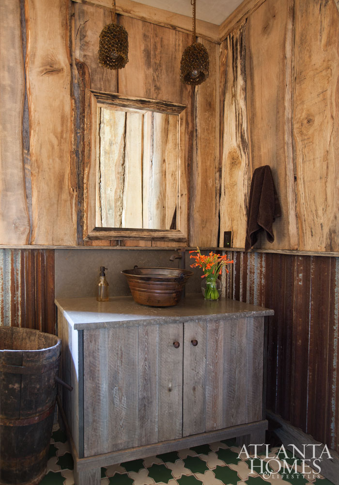 While The Homes Rustic Atmosphere Is Present In This Bath Via Corrugated Metal Wainscoting It Tempered By A Mosaic Tile Floor