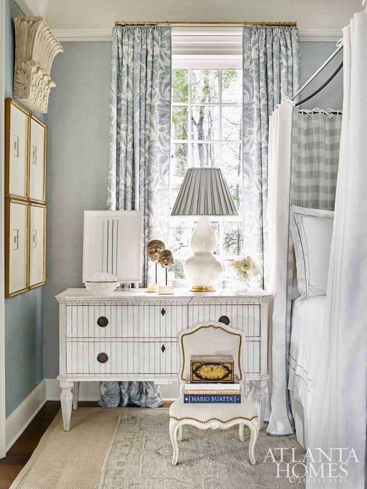 Beautiful blue bedroom with canopy bed and beadboard chest