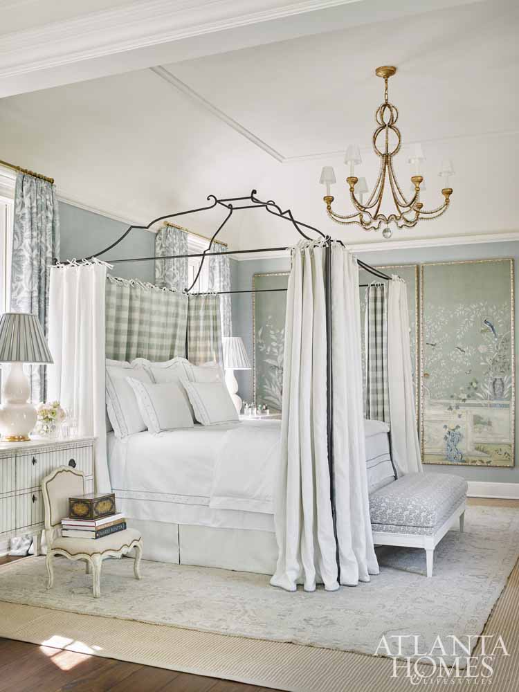 Blue gingham curtain panels on beautiful bed in elegant bedroom - Southeastern Designer Showhouse