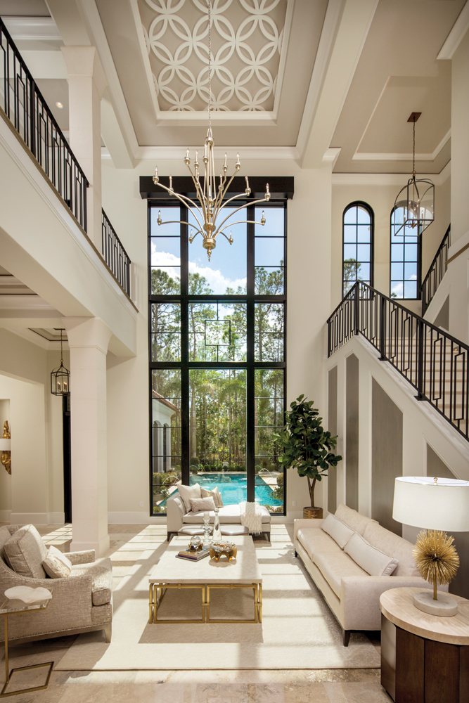 A 20 Foot Window Overlooking The Pool Is Focal Point In Grand Living Room Inside Capolavoro Mansion Within Four Seasons Private Residences