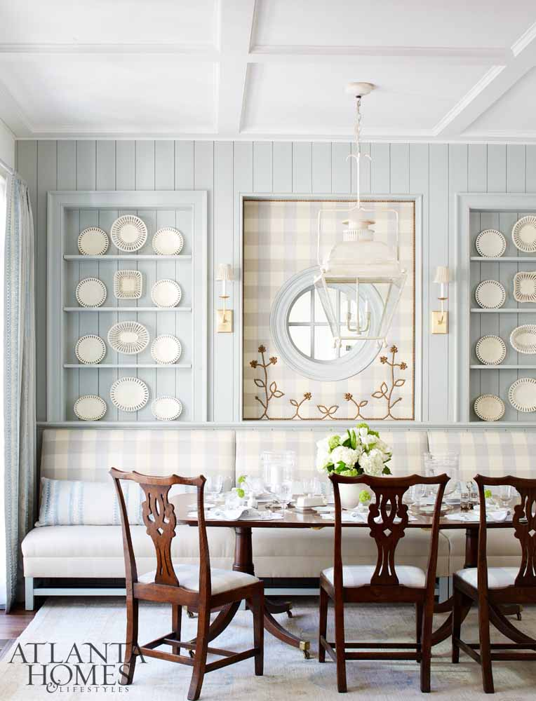 Lauen DeLoach upholstered the window surround, adding nailhead trim for unexpected elegance.