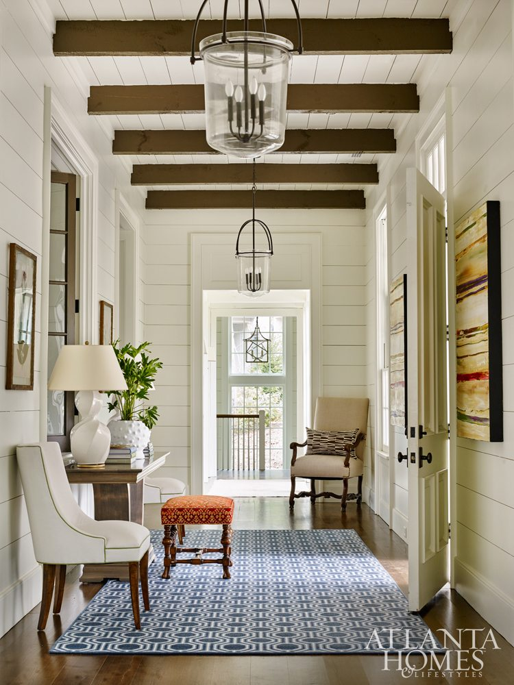He Achieved An Inviting Atmosphere When Designing The Entryway By Using  Interior Windows Made To Look Antique. They Peer Into The Sunken Living  Room, ...